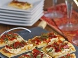 Bourbon brie flatbread with fig jam and prosciutto