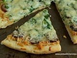 Smoked sausage pizza with arugula and caramelized onion and goat cheese sauce