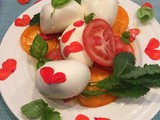 Caprese Salad with red impatiens flower dressing