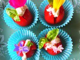 Cherry tomatoes with raw nut cheese and edible flowers