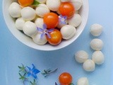 French  Caprese Salad? Cherry tomatoes, bocconcini and blue borage flowers