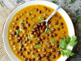 Gujarati Rasawala chana (Black chickpeas simmered in a gram flour curry)