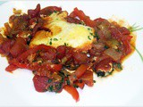 Eggs in a skillet with spicy tomato and bell pepper sauce Ellie Krieger