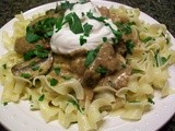 Beef Stroganoff Over Buttered Egg Noddles with Herbs