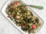 Sicilian long zucchini and its greens with tomatoes / cucuzza e tenerumi al pomodoro