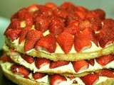 Almond sponge cake moistened by white chocolate buttercream and fresh strawberries