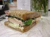 A picture with deli turkey with cucumber and mixed greens