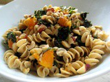 Pasta with Braised Kale, Butter Beans, and Hazelnuts
