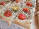 Focaccia with cherry tomatoes and herbs