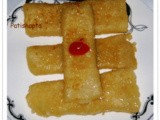Patishapta (Maida and Moong Crepes with Kheer Filling)