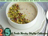 Shahi phirni with pistachios and fruit toppings