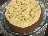Egg free coffee cake topped with cream & pistachio