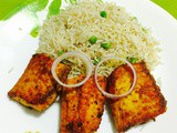 Shallow fried spiced fish with garlic pepper rice