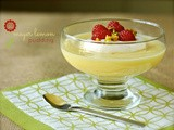 Meyer lemon pudding with chantilly cream, raspberries, and pistachios