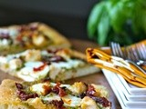 Pesto pizza with chicken, mozzarella, and sun-dried tomatoes