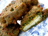 Christmas starters and sides-Goats cheese pakora in a spinach, sundried tomato, fennel, cumin and gram flour batter