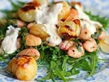 Pomegranate roasted baby onions with butter bean salad and tahini-chilli yogurt