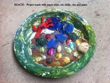 Beach - project made with paper plate, sea shells, paint, colored sand and clay