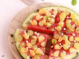 Watermelon Pizza with assorted Fruits & Chocolates