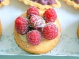 Lime, white chocolate curd and raspberry tartlets on Sablé Breton