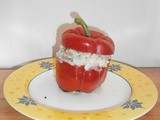 Bell peppers stuffed with a mushrooms-mozzarella risotto
