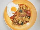 False ratatouille of several vegetables and fried eggs