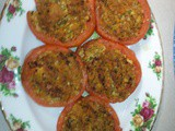 Baked Stuffed Tomato loaded with veggies / cheese / nuts