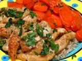 Chicken strips in a cognac cream sauce with glazed carrots over brown rice