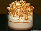Chocolate ganache & salted caramel panna cotta trifle topped with whipped cream & caramel popcorn