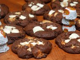 Reese's white peanut butter cups baked into thick, chocolate cookies