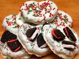 White chocolate dipped pretzels topped with candy cane oreos