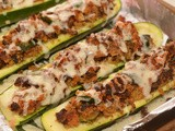 Zucchini boats stuffed with bacon, breadcrumbs & cheese
