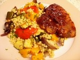 Mediterranean style giant couscous with barbecue pork chops