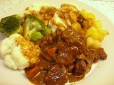 Slow cooked Cumberland beef stew with donkey carrots