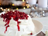 Pavlova with pomegranate and cranberry sauce