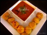 Batata Vada Rassa / Aloo Bonda with Black Chickpeas Curry