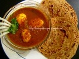 Egg curry in tamarind sauce and wheat lacha paratha