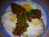 Fried eggs with minced meat