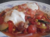 Mozzarella Stuffed Chicken with Mediterranean Tomato Sauce
