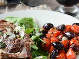 Beef tagliata with olives and tomatoes
