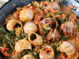 Snails with tomato and spinach