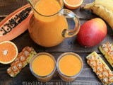 Tropical fruit smoothie {with papaya, pineapple, banana, mango, and orange}