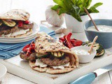 Barbecued lamb flatbread burgers with cucumber-yoghurt sauce recipe