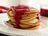 Yeast pancakes with raspberry sauce