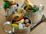 Fun for kids: Easter eggs and bunnies in miniature watering cans