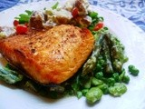 A splendid fish supper: grilled salmon with a warm salad of spring vegetables