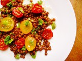 A zesty beluga lentil and roasted tomato salad with herbs