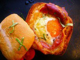 Fancy breakfast or brunch? baked egg and proscuitto in a bread roll