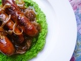 Summery sausages and caramelised onions with crushed buttered peas