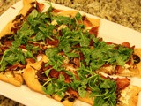 143.0...Ricotta and Caramelized Onion Flatbread Topped with Prosciutto and Arugula